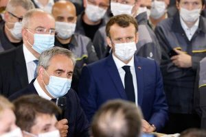 Luca de Meo, left, of Renault, speaking with Emmanuel Macron, the president of France, on Monday. Mr. de Meo said Renault had reached an agreement with labor unions to allow the changes needed to shift to electric car production.